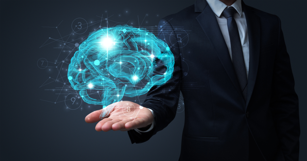 Businessman holding human brain on his hand with logistics symbols around